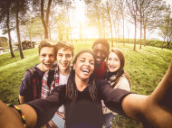 stock-photo-38548252-selfie-of-young-multiethnic-friends-in-a-park