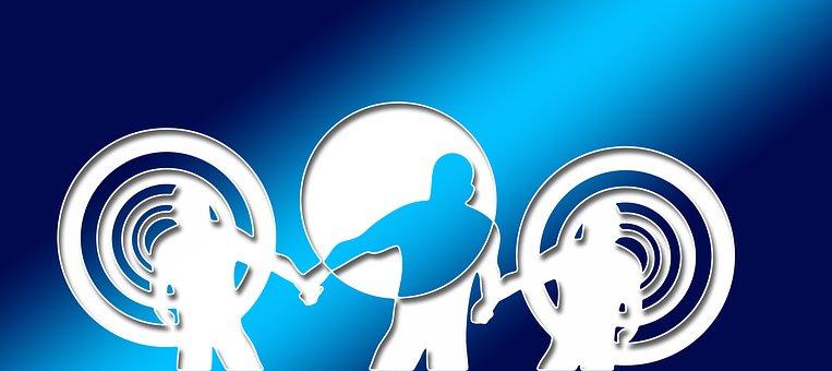 Una silueta d'adult que dóna la mà a 2 joves