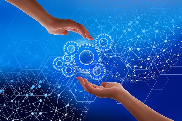 Dos mans que es transfereixen tecnologia enmig d'una xarxa