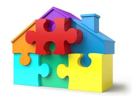 Una casa construïda amb peces de puzzle